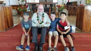 Father Michael Lapsley and students at the Iolani School in Honolulu